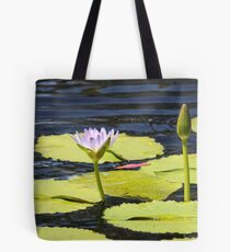 Lily Pad in Flower on Rippling Pond. Tote Bag