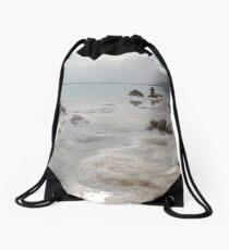 White chunks of salt in the dead sea Drawstring Bag