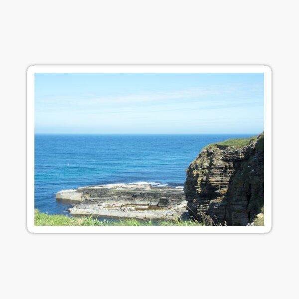 Rocks and raised ledge in sea Sticker