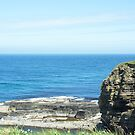 Rocks and raised ledge in sea by SiobhanFraser