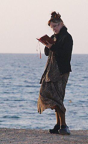 praying pilgrim on the water.  by yuval  doron