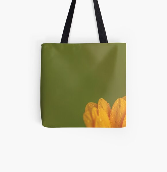 Wet Yellow Petals against Green background All Over Print Tote Bag