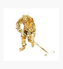 Golden female ice hockey player Photographic Print