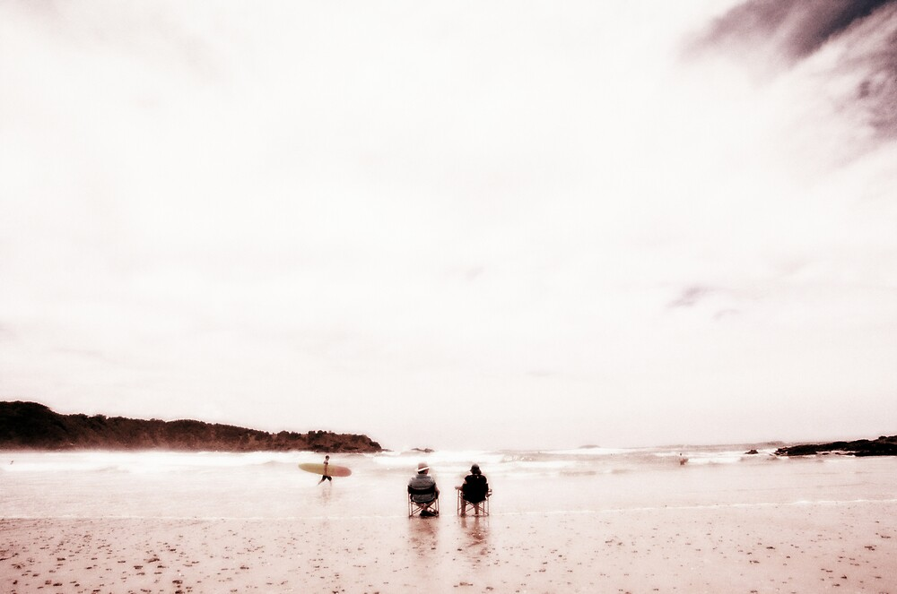 Surfer and Seated Couple on Diggers Beach, Coffs Harbour by Colin Leal