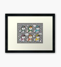 Husky puppies in colorful raincoats Framed Print