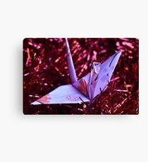 Pink patterned paper crane on red tinsel Canvas Print