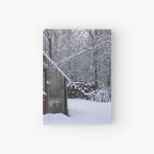 Greenhouse on a snowy day Hardcover Journal