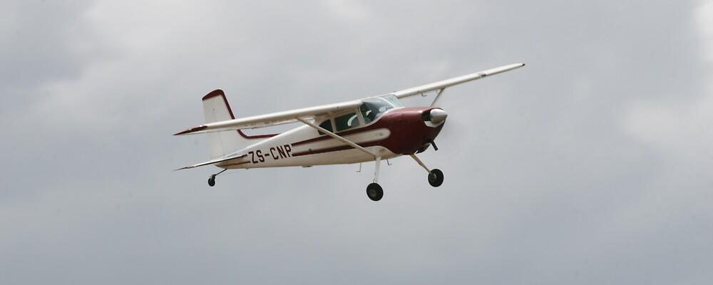 Bush Pilot Fly Past by Paul Lindenberg