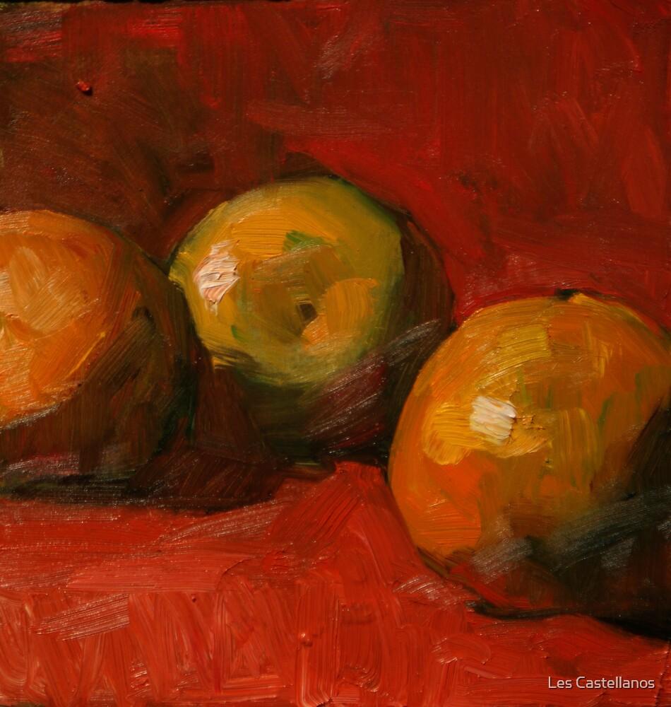 Three Small Oranges by Les Castellanos