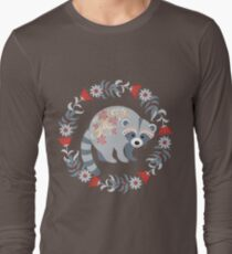 Raccoon in a frame of leaves and flowers. Style folk art.  T-Shirt