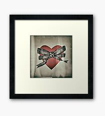 Bow and heart Framed Print