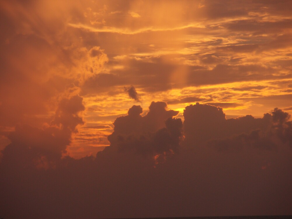 Stormy clouds at sunset by presbi