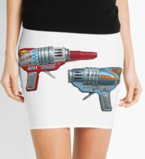 1950s Toy Ray Guns - Japanese Tin Toy Spaceman Ray Guns Mini Skirt