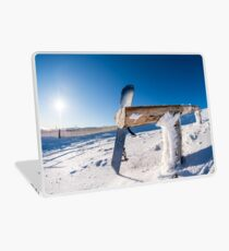 Snowboard leaning on a wood rail Laptop Skin