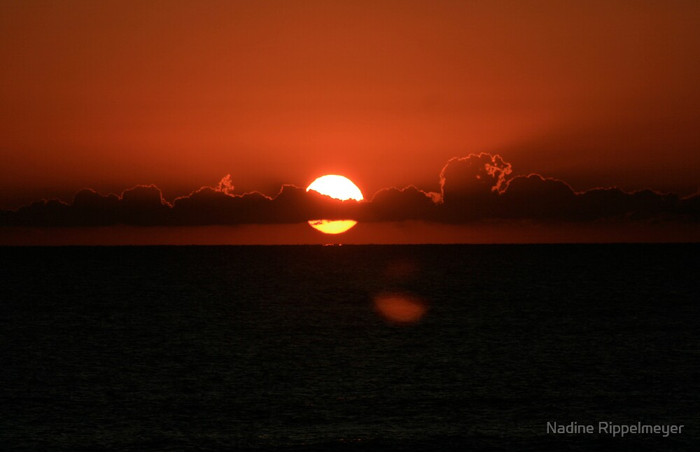 Red Sunset Over the Atlantic by Nadine Rippelmeyer