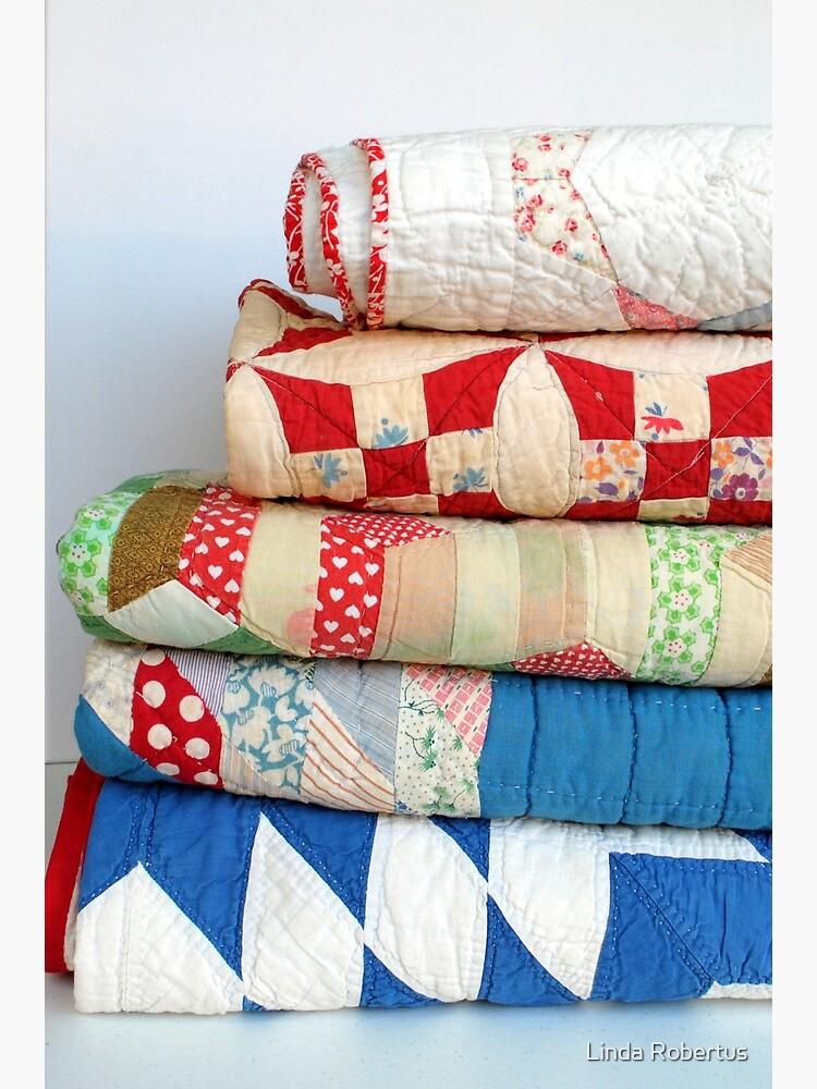 Stack of vintage patchwork quilts by bluejacaranda