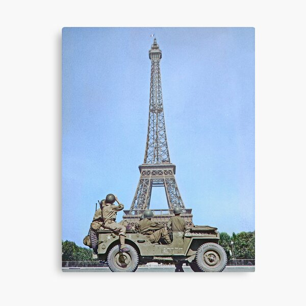 American soldiers watch as the Tricolor flies from the Eiffel Tower again, c. 25 August 1944, Paris, France. Canvas Print