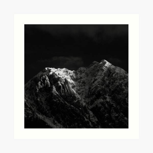 Sunlight hitting the mountains black and white Art Print