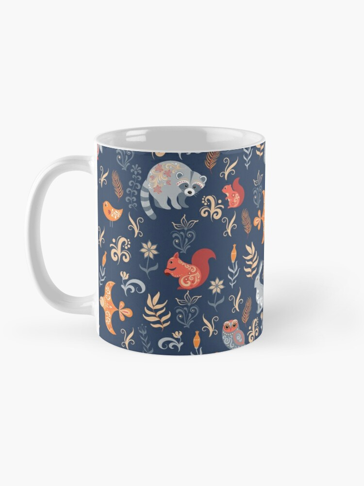 Alternate view of Fairy-tale forest. Fox, bear, raccoon, owls, rabbits, flowers and herbs on a blue background. Mug