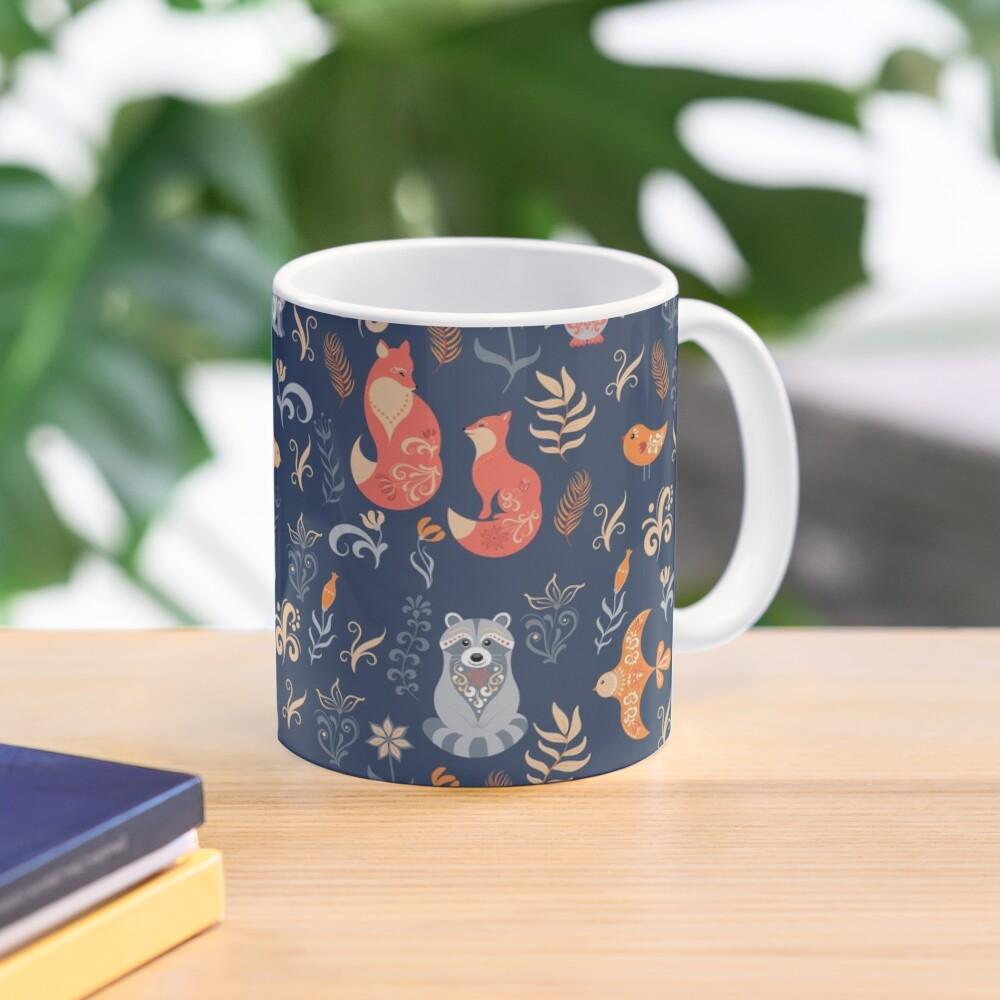 Fairy-tale forest. Fox, bear, raccoon, owls, rabbits, flowers and herbs on a blue background. Mug