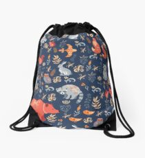 Fairy-tale forest. Fox, bear, raccoon, owls, rabbits, flowers and herbs on a blue background. Drawstring Bag