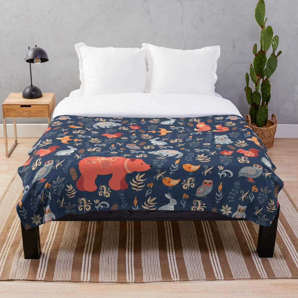Fairy-tale forest. Fox, bear, raccoon, owls, rabbits, flowers and herbs on a blue background. Throw Blanket