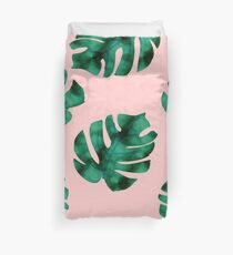 Tropical fern leaves on peach Duvet Cover