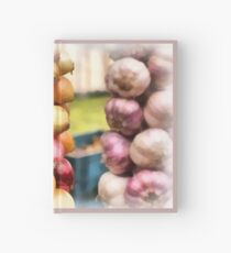 Decorative onions hanging on a string on a farmers market Hardcover Journal
