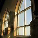 light beams through church windows by michelle bergkamp
