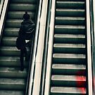 Young woman on an escalator by Sharonroseart