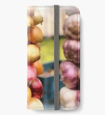 Decorative onions hanging on a string on a farmers market iPhone Wallet/Case/Skin