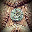 Door with Buddha on Ibiza. by Dirk van Laar