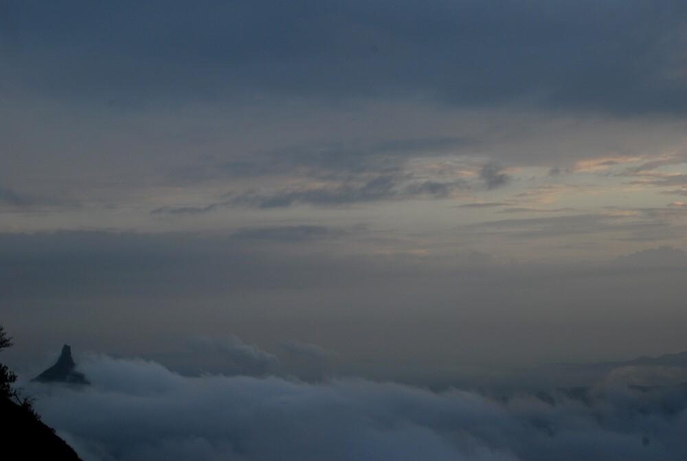Peak Shrouded amidst clouds by filemot