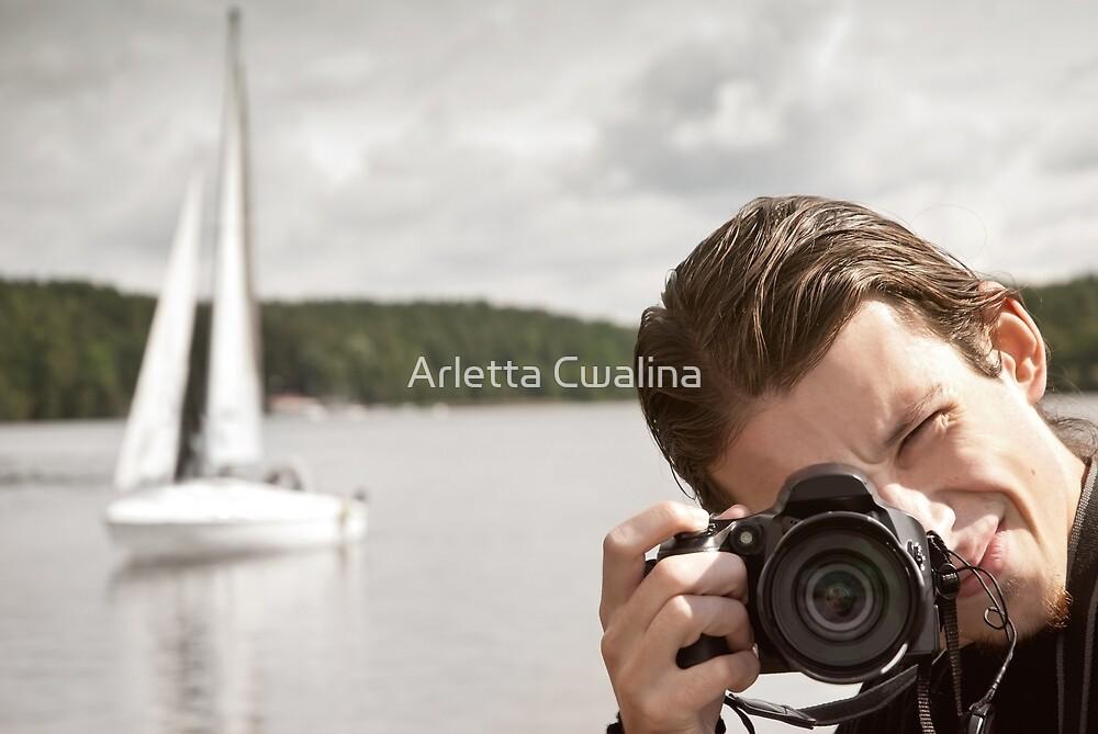 European man taking photo by Arletta Cwalina