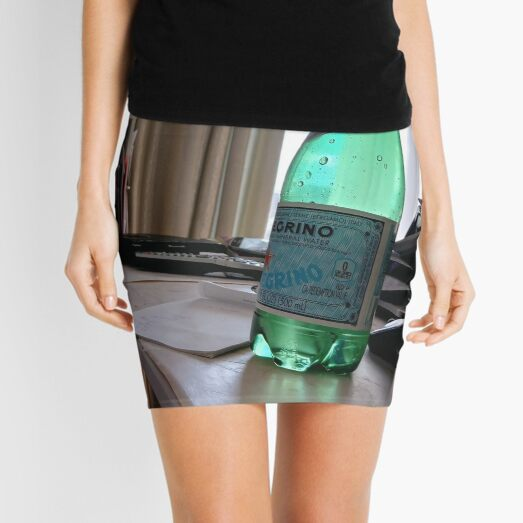 A bottle of water on the table Mini Skirt