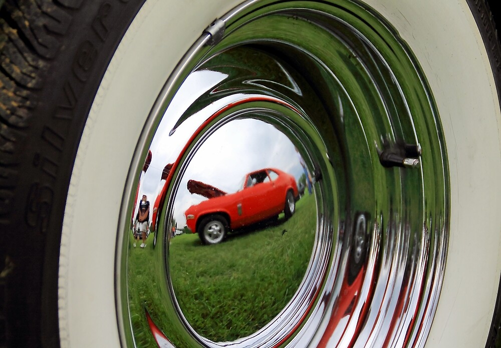 Car tire reflection by Karl Rose