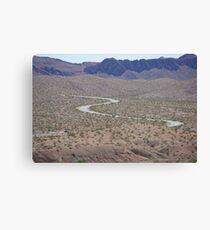 Winding through the desert Canvas Print