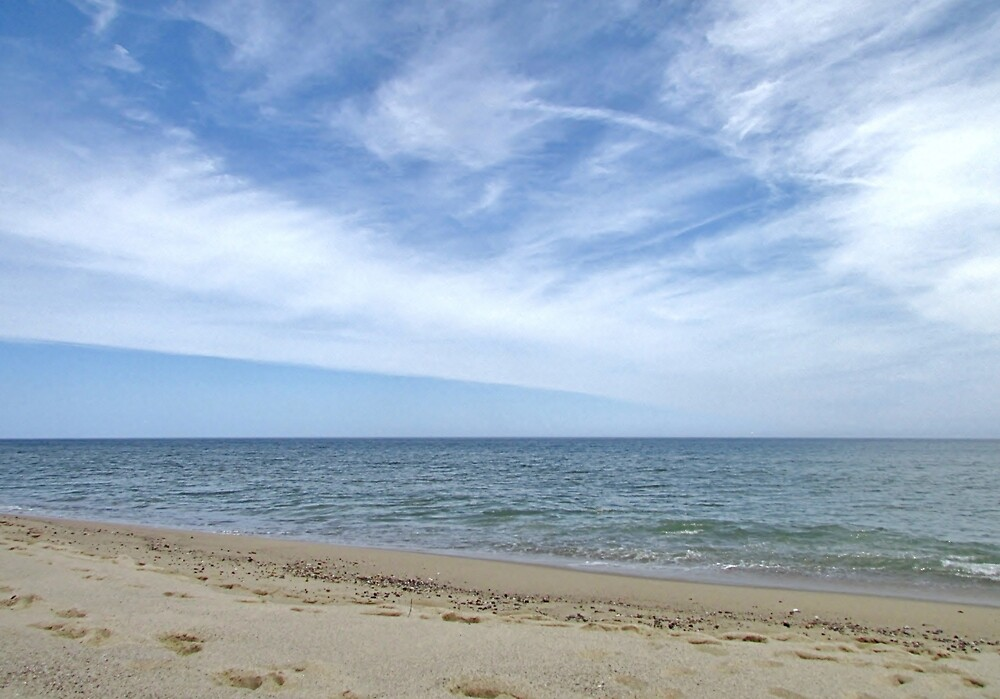 Sandy ocean beach under pretty blue sky by Linda Crockett