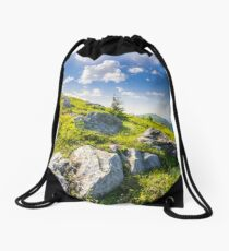 boulders on the hillside in high mountains at sunrise Drawstring Bag