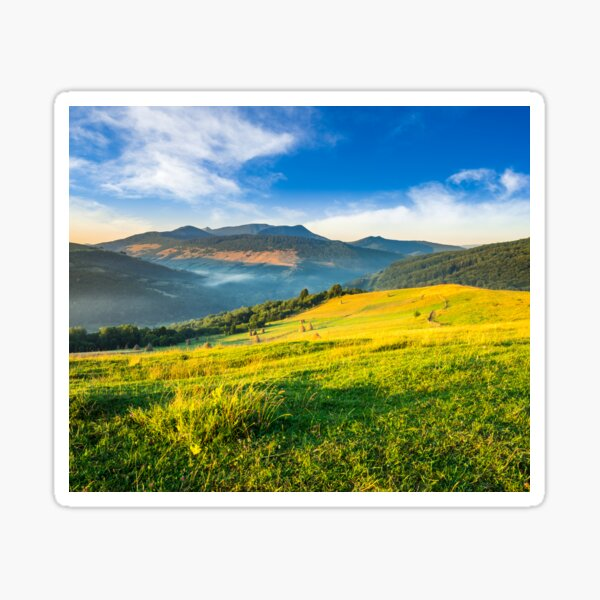haystacks in agricultural field in mountain Sticker