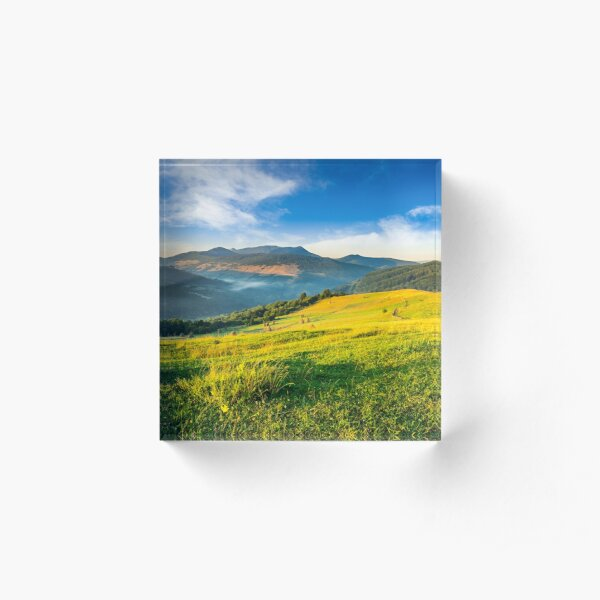haystacks in agricultural field in mountain Acrylic Block