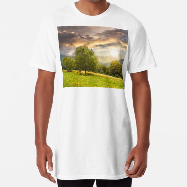 meadow near the forest in mountains at sunset Long T-Shirt
