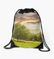 meadow near the forest in mountains at sunset Drawstring Bag