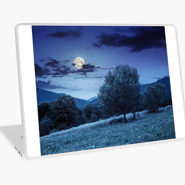 meadow near the forest in mountains at night  Laptop Skin