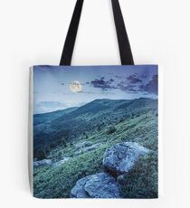 white boulders on the hillside at night Tote Bag