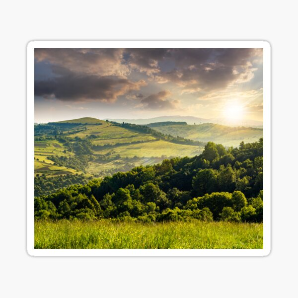 agricultural fields in mountains at sunset Sticker