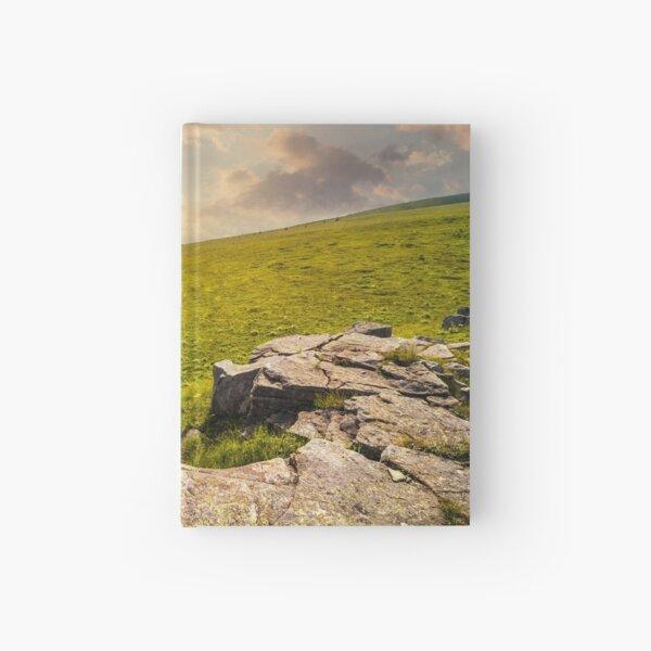 white boulders on the hillside at sunset Hardcover Journal