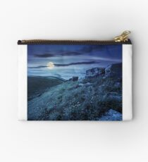 boulders on hillside in high mountains at night Studio Pouch