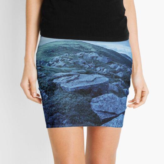 white boulders on the hillside at night Mini Skirt