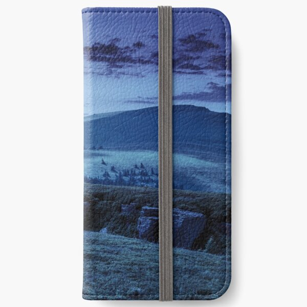 mountain peak behind hillside with boulders at night iPhone Wallet